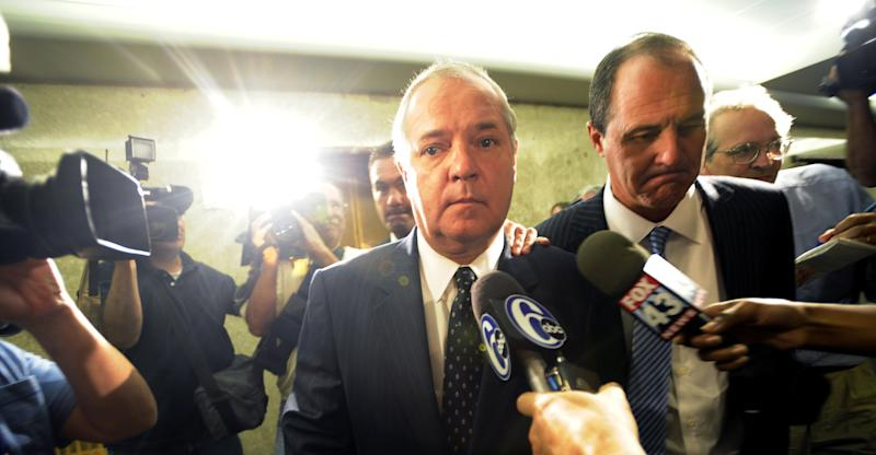 Former Pennsylvania House Speaker John Perzel, R-Philaldephia, left, along with his attorney Brian McMonagle, right, exits a Dauphin County  Courtroom Wednesday, Aug. 31, 2011, in Harrisburg, Pa. Perzel entered a guilty plea Wednesday to two counts of conflict of interest, two counts of theft and four counts of conspiracy. (AP Photo/ Bradley C Bower)