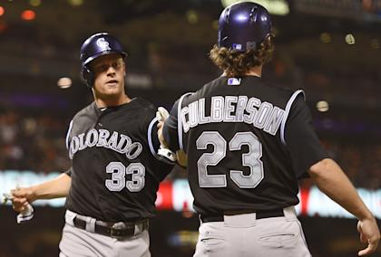 Justin Morneau (L) and Charlie Culberson celebrate after they both scored in the top of the 9th inning vs. the Giants on Friday. (Getty)