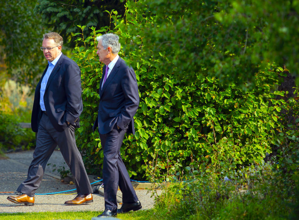 John Williams President and CEO of the Federal Reserve Bank of New York, and Jerome Powell, Chairman of the Board of Governors of the Federal Reserve System walk together after Powell's speech at the Jackson Hole Economic Policy Symposium on Friday, Aug. 24, 2018 in Jackson Hole, Wyo. (AP Photo/Jonathan Crosby)