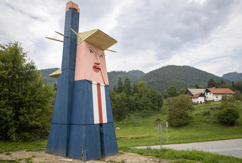 A wooden statue resembling Donald Trump is built near Kamnik, Slovenia, Friday, Aug. 30, 2019. Only weeks after Melania Trump statue was erected in her home town of Sevnica, Slovenia, another statue, now of her husband Donald, has been erected not far from there. (AP Photo/Darko Bandic)
