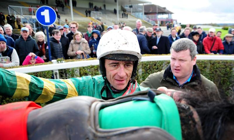 Gordon Elliott greets Davy Russell as the jockey unsaddles Chirico Vallis at Navan