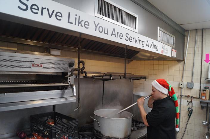"""<span class=""""s1"""">A chef prepares hot meals for homeless men, women and children at the Bowery Mission's flagship location at 227 Bowery in Manhattan. (Photo: Michael Walsh/Yahoo News)</span>"""