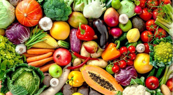 a table loaded with numerous fruits and vegetables