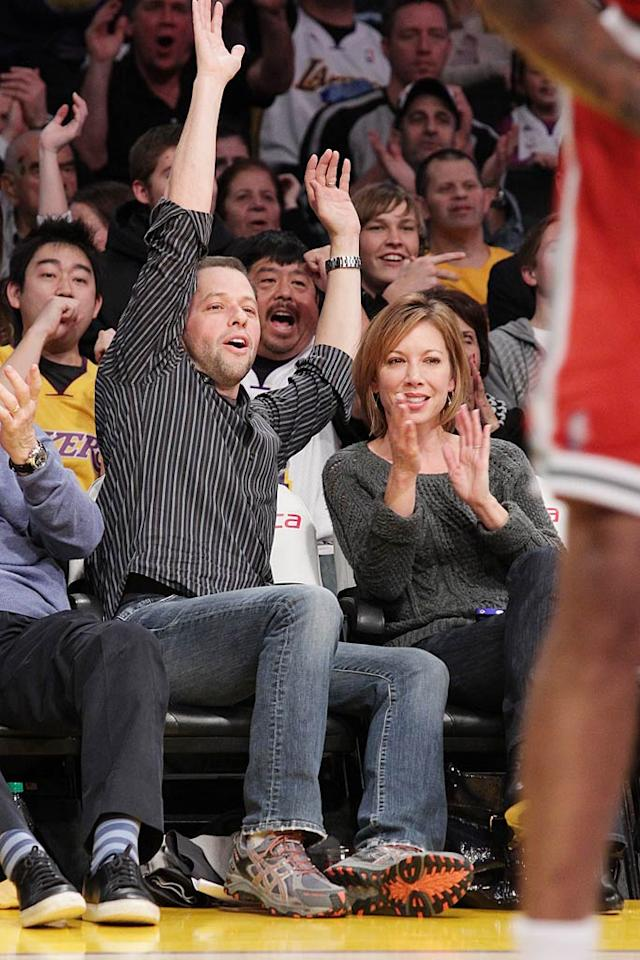 """Two and a Half Men"" star Jon Cryer and his wife Lisa Joyner celebrated as the Lakers scored a basket. Noel Vasquez/<a href=""http://www.gettyimages.com/"" target=""new"">GettyImages.com</a> - December 21, 2010"