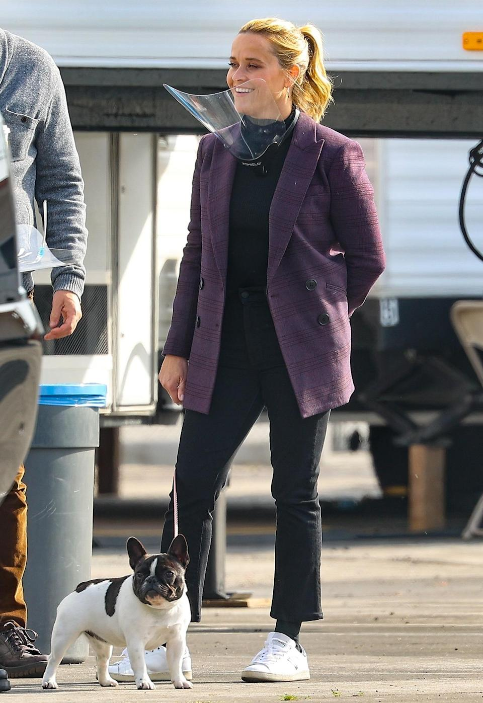 <p>Reese Witherspoon brings her dog along to the set of <em>The Morning Show</em> on Monday in L.A.</p>