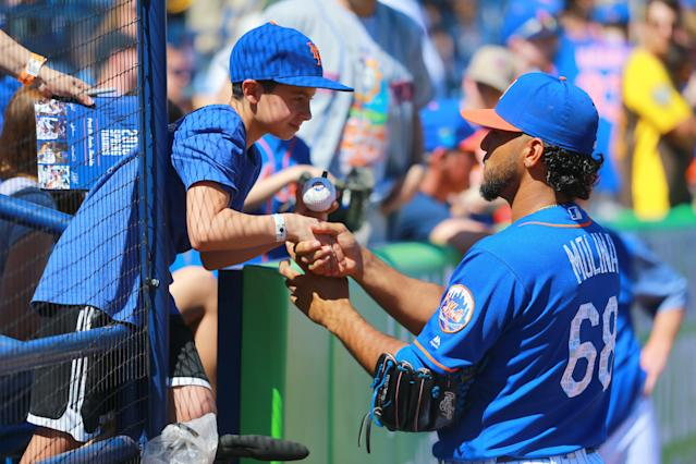 <p>New York Mets pitcher Marcos Molina shakes the hand of a young fan before signing an autograph before the start of a baseball game against the St. Louis Cardinals at First Data Field in Port St. Lucie, Fla., Feb. 24, 2018. (Photo: Gordon Donovan/Yahoo News) </p>