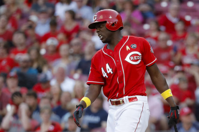 Cincinnati Reds' Aristides Aquino reacts after striking out against Arizona Diamondbacks relief pitcher Jimmie Sherfy to close the ninth inning of a baseball game, Saturday, Sept. 7, 2019, in Cincinnati. (AP Photo/John Minchillo)