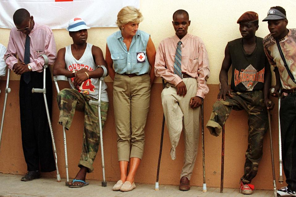 FILE PHOTO OF 13JAN97 - Diana, Princess of Wales talks to amputees during her visit to Angola as part of the Red Cross campaign against land mines, 13 January 97. Princess Diana and her companion Dodi Al Fayed died in a car carsh in Paris August 31 after being chased by photographers on motorcycles.  DIANA