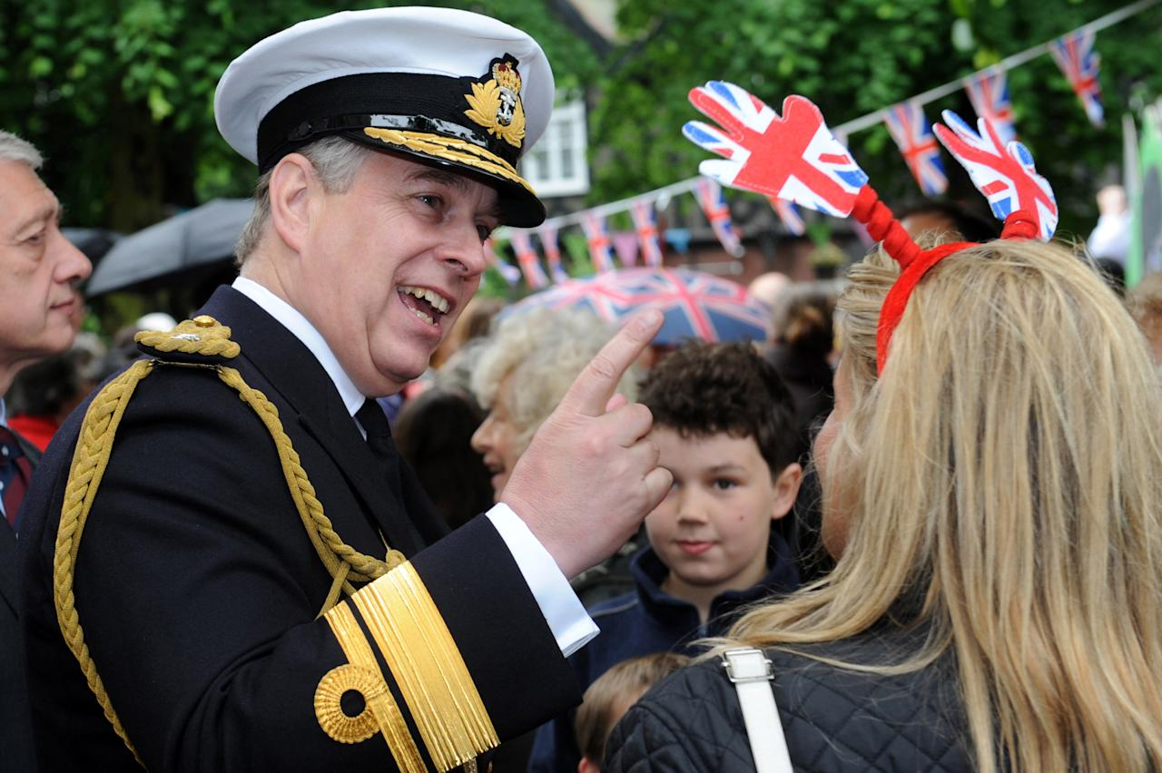 LONDON, ENGLAND - JUNE 03:  Prince Andrew, Duke of York attends the 'Big Jubilee Lunch' at All Saints Church in Fulham ahead of the Diamond Jubilee River Pageant on June 3, 2012 in London, England. For only the second time in its history the UK celebrates the Diamond Jubilee of a monarch. Her Majesty Queen Elizabeth II celebrates the 60th anniversary of her ascension to the throne. Thousands of well-wishers from around the world have flocked to London to witness the spectacle of the weekend's celebrations. The Queen along with all members of the royal family will participate in a River Pageant with a flotilla of a 1,000 boats accompanying them down The Thames.  (Photo by Matt Grayson - WPA Pool/Getty Images)