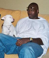 Cornelius Green with Nevin Shapiro's dog in the booster's $2.7 million home in 2002.
