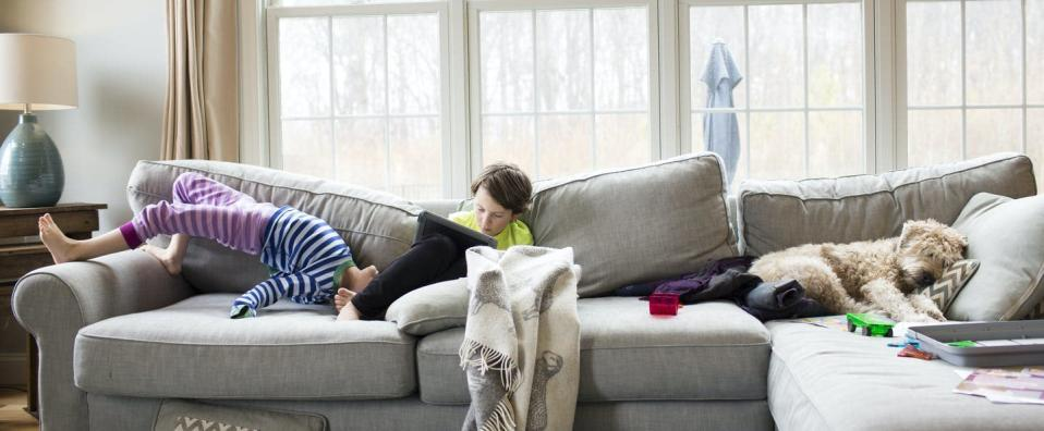 "<span class=""caption"">Logging into school on the couch can make homelife more topsy-turvy.</span> <span class=""attribution""><a class=""link rapid-noclick-resp"" href=""https://www.gettyimages.com/detail/photo/siblings-on-sofa-at-home-royalty-free-image/961127740"" rel=""nofollow noopener"" target=""_blank"" data-ylk=""slk:Cavan Images/Getty Images"">Cavan Images/Getty Images</a></span>"