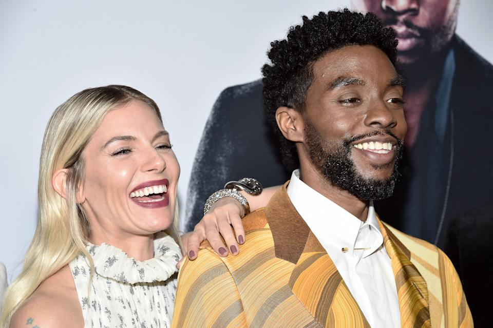 "NEW YORK, NEW YORK - NOVEMBER 19: Sienna Miller and Chadwick Boseman attend ""21 Bridges"" New York Screening at AMC Lincoln Square Theater on November 19, 2019 in New York City. (Photo by Steven Ferdman/WireImage)"