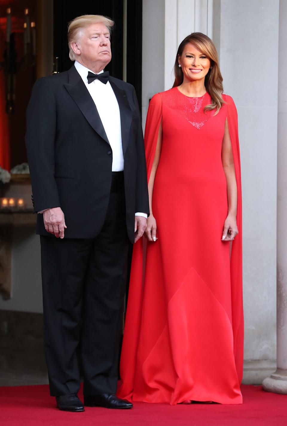 The US First Lady chose a sweeping red caped gown for the state dinner [Photo: Getty]