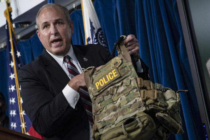Mark Morgan, the acting Customs and Border Protection commissioner, holds up a protective vest worn by CBP agents in Portland during protests. (Samuel Corum/Getty Images)
