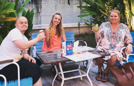 Angie Kent with co-star Yvie Jones and housemate Tom Hancock pose with cocktails in Bali