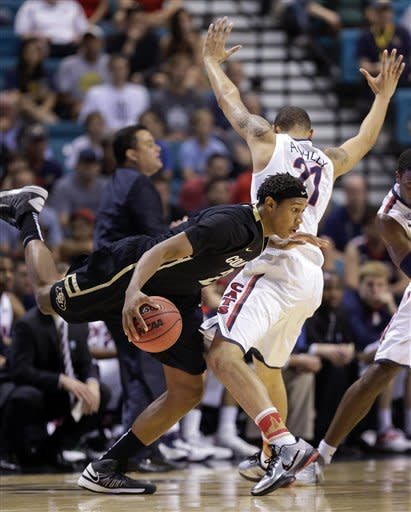 Colorado's Xavier Johnson (2) is fouled by Arizona's Brandon Ashley (21) as he drives the ball around the perimeter in the first half during a Pac-12 tournament NCAA college basketball game, Thursday, March 14, 2013, in Las Vegas. (AP Photo/Julie Jacobson)