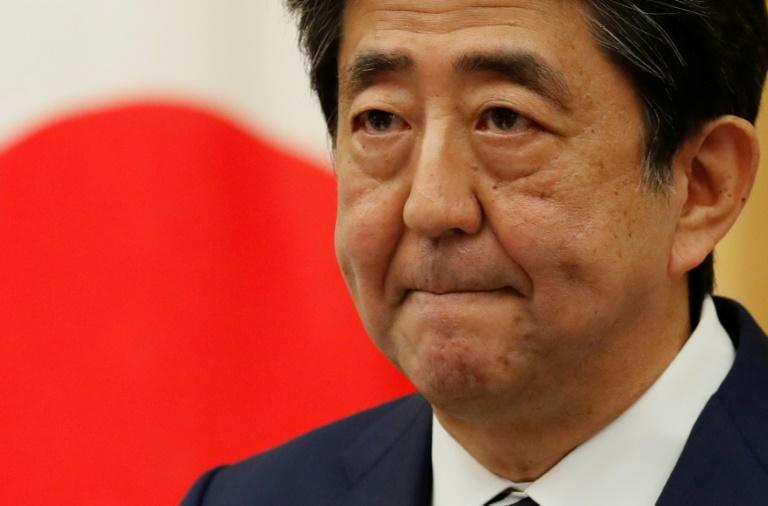 Shinzo Abe: record-breaking PM undone by health woes