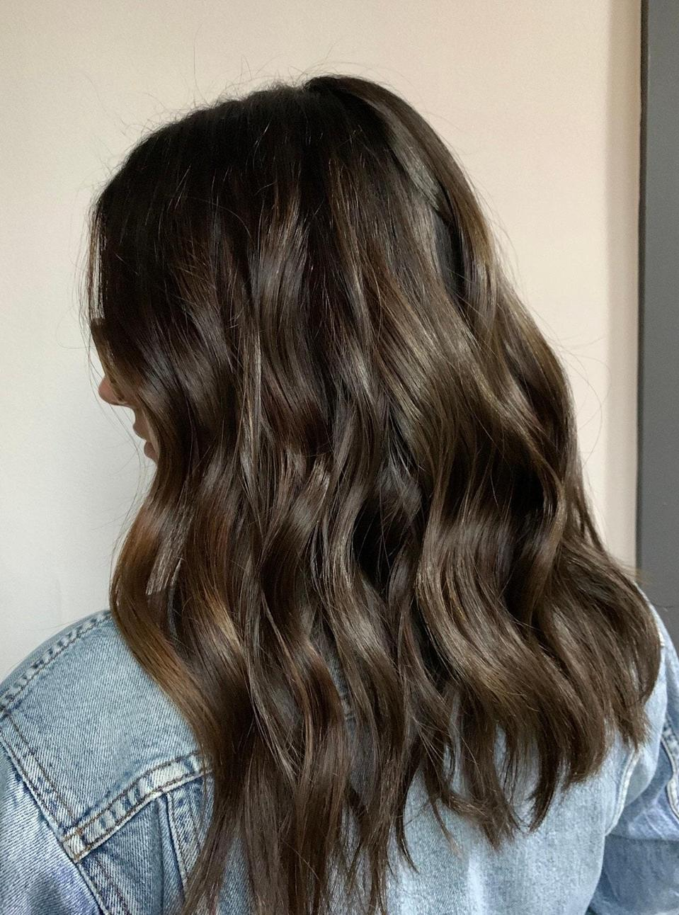 "While warmer tones are trending, that doesn't mean cooler tones are still equally stunning. If you're looking to break up your brunette without making a major change, try barely there cool-brown highlights. Keep your base dark, but ask for some soft, cool balayage highlights, says Grummel: ""A gloss will also help add extra shine to a dull brunette and get rid of any unwanted red tones."""