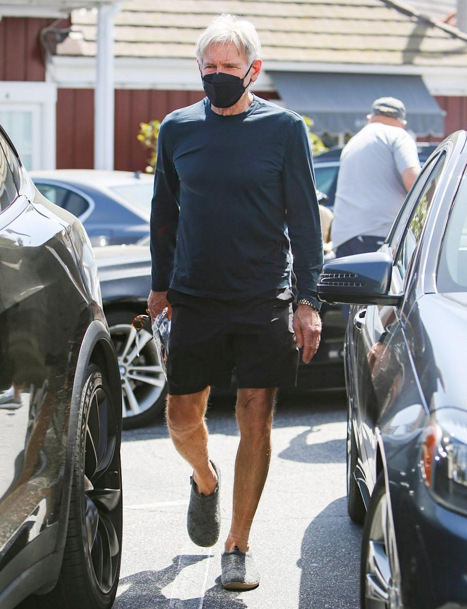 <p>Harrison Ford steps out in a black mask, shorts and sneakers on Tuesday in L.A.</p>