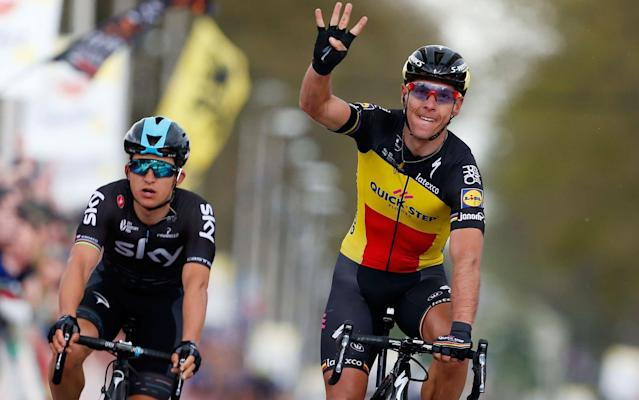 Philippe Gilbert celebrates after beating Michal Kwiatkowski in a two-up sprint to win the fourth Amstel Gold Race of his career in Holland on Sunday - AFP