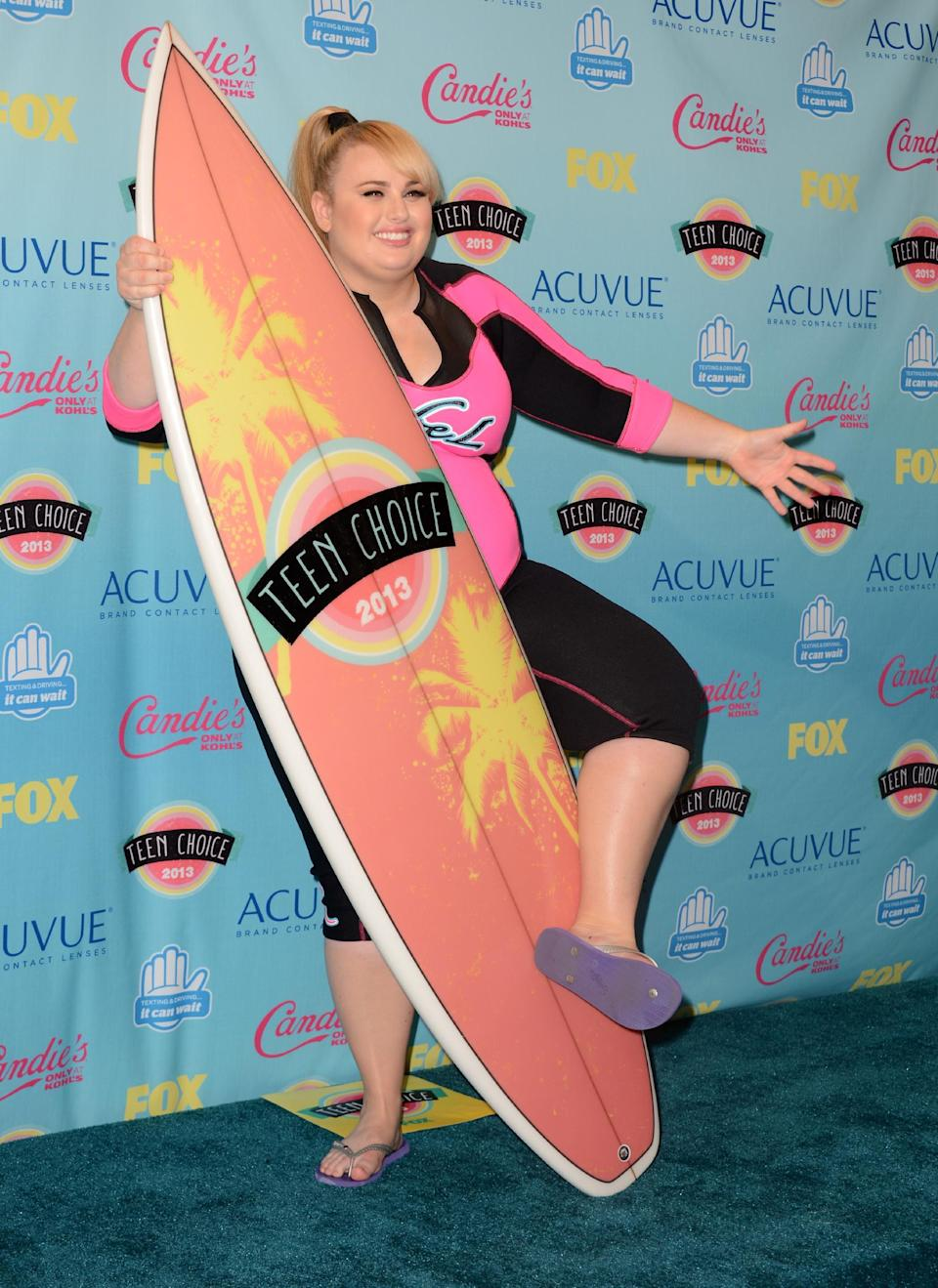 """Rebel Wilson poses backstage with the award for choice movie actress: comedy for """"Pitch Perfect"""" at the Teen Choice Awards at the Gibson Amphitheater on Sunday, Aug. 11, 2013, in Los Angeles. (Photo by Jordan Strauss/Invision/AP)"""