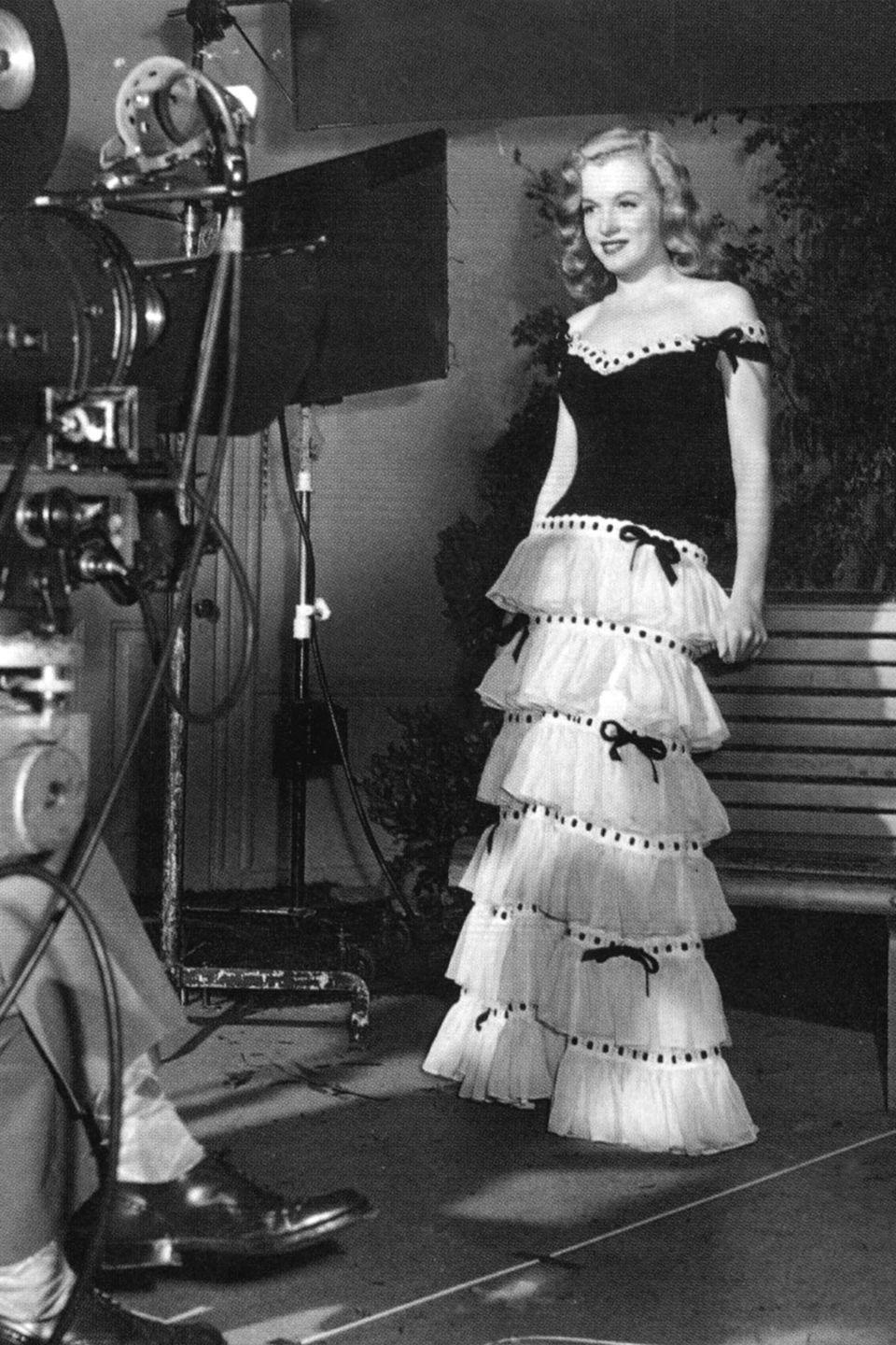 <p>After meeting photographer David Conover in 1944, she signed with Blue Book Model Agency and her modeling segued into acting when she met executive Ben Lyon of 20th Century Fox where she performed a screen test (pictured above). She was granted a divorce from Dougherty to focus on her acting career.</p>