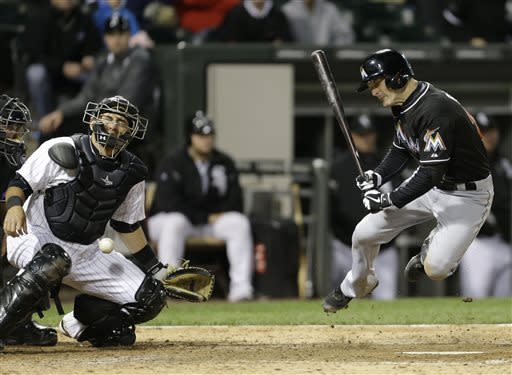 Miami Marlins' Nick Green, right, reacts after being hit by pitch as Chicago White Sox catcher Hector Gimenez also reacts during the 10th inning of a baseball game, Friday, May 24, 2013, in Chicago. (AP Photo/Nam Y. Huh)