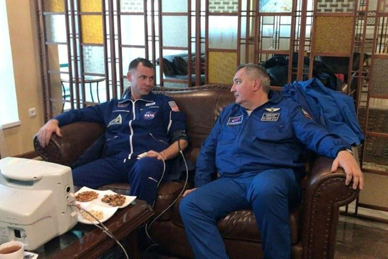 US astronaut Nick Hague, left, and Russian cosmonaut Aleksey Ovchinin after making a safe emergency landing