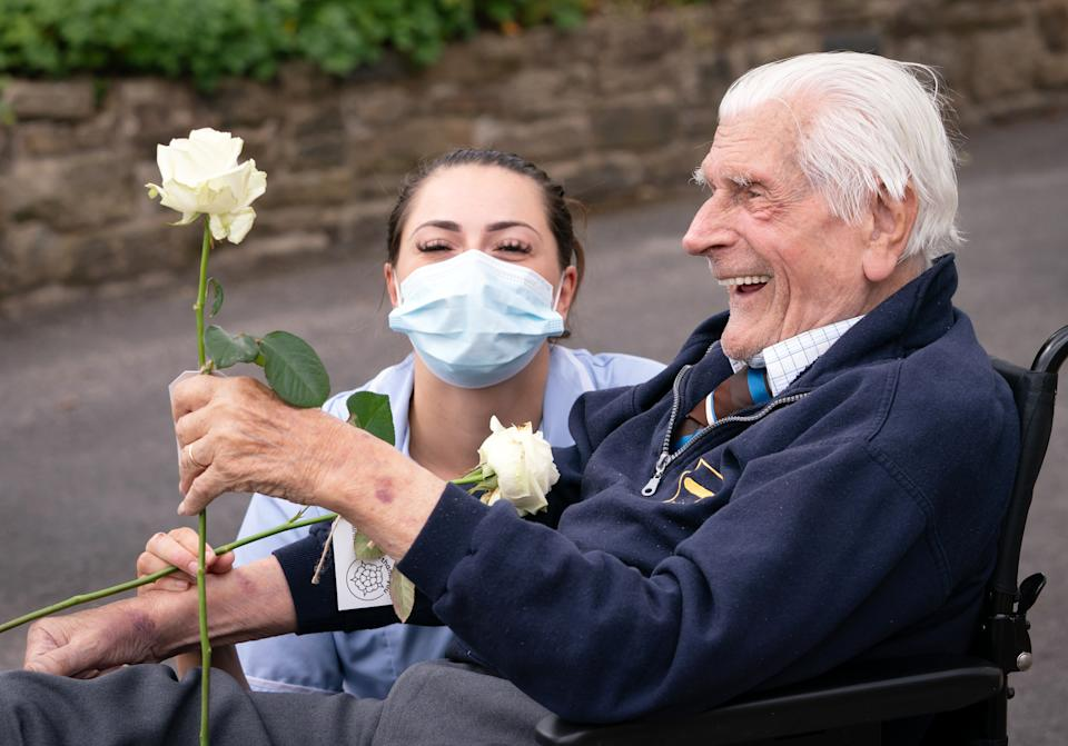 Health Care Assistant Rose Waddington and ninety-eight-year-old resident John Kykot are pictured with