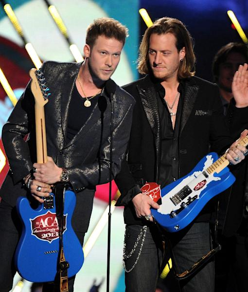 "Brian Kelley, left, and Tyler Hubbard, of musical group Florida Georgia Line, accept the single of the year award for ""Cruise"" at the American Country Awards at the Mandalay Bay Resort & Casino on Tuesday, Dec. 10, 2013, in Las Vegas, Nev. (Photo by Frank Micelotta/Invision/AP)"