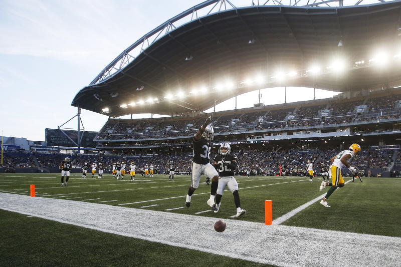 Oakland Raiders' Keisean Nixon (38) celebrates after knocking away a pass in the end zone intended for Green Bay Packers' Equanimeous St. Brown (19) during the first half of an NFL preseason football game Thursday, Aug. 22, 2019, in Winnipeg, Manitoba. (John Woods/The Canadian Press via AP)