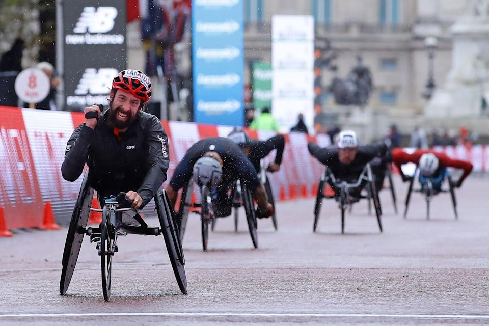 <p>Brent Lakatos of Canada crosses the finish line to win the men's pushrim race</p>