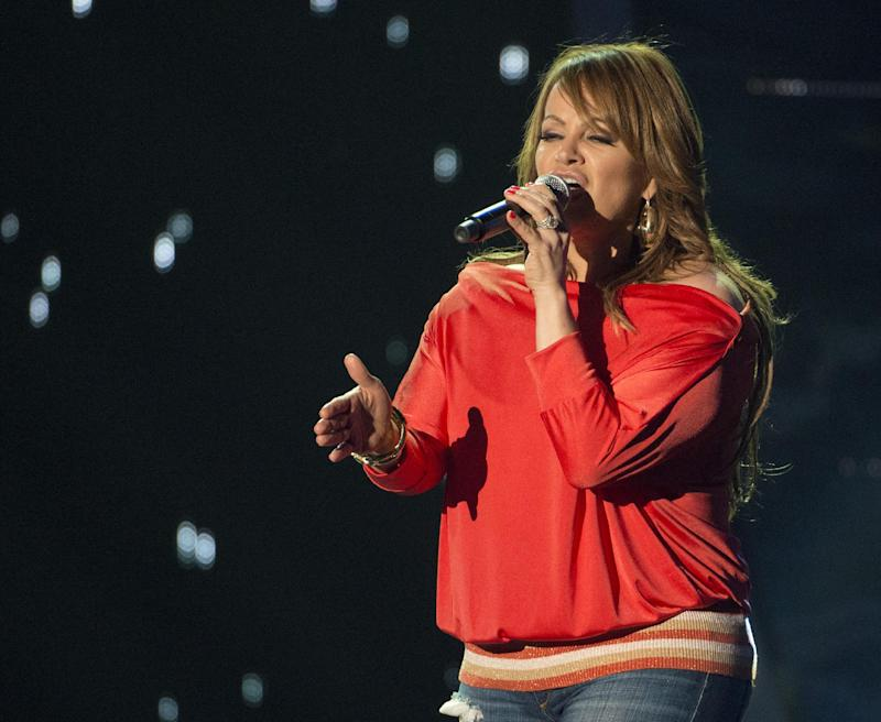 This April 25, 2012 photo released by Telemundo shows Latin singer Jenni Rivera rehearsing for the 2012 Billboard Latin Music Awards, at the BankUnited Center in Coral Gables, Fla. The wreckage of a small plane believed to be carrying Mexican-American music superstar Jenni Rivera was found in northern Mexico on Sunday and there are no apparent survivors, authorities said. (AP Photo/Telemundo, Gary I Rothstein/Telemundo)