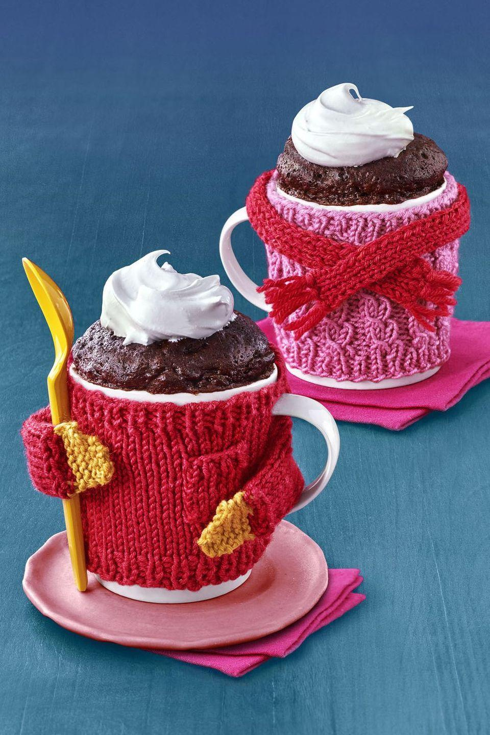 """<p>Only the nicest things come in our favorite coffee mugs, and this soul-warming chocolate cake is no exception! You'll use cocoa powder to create the base of this rich cake that's finished with a dollop of sweet cream. This ultra-satisfying dessert is ready in 8 minutes flat. </p><p><a href=""""https://www.womansday.com/food-recipes/food-drinks/recipes/a57924/microwave-mug-cake-recipe/"""" rel=""""nofollow noopener"""" target=""""_blank"""" data-ylk=""""slk:Get the recipe from Woman's Day »"""" class=""""link rapid-noclick-resp""""><em>Get the recipe from Woman's Day »</em></a></p>"""