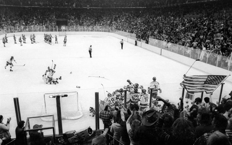 "In this Feb. 22, 1980, photo, the United States Olympic hockey team celebrated its upset victory over the Soviet Union, the four-time defending Olympic champions, during the medal-round of the Winter Olympics in Lake Placid, N.Y. Tourism is a $1.2 billion industry in the Lake Placid region, much of it still fueled by the memory of the U.S. hockey team beating the Soviet Union as the ""Miracle on Ice"" highlight of the 1980 Olympic Games. (Tom Sweeney/Star Tribune via AP)"