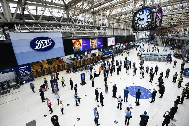 Rail staff stand pay tribute at London's Waterloo station