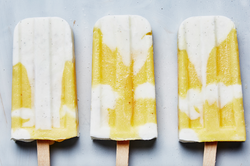 """For this updated creamsicle-inspired recipe, we swapped the icy orange layer for a creamy citrus curd and paired it with alternating layers of a sweet-tart frozen yogurt. <a href=""""https://www.bonappetit.com/recipe/creamsicle-orange-pop-recipe?mbid=synd_yahoo_rss"""" rel=""""nofollow noopener"""" target=""""_blank"""" data-ylk=""""slk:See recipe."""" class=""""link rapid-noclick-resp"""">See recipe.</a>"""