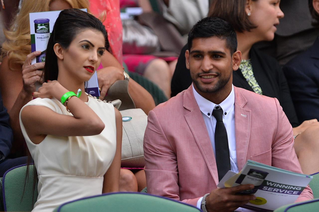 British boxer Amir Khan (R) and his partner Faryal Makhdoom (L) sit in the royal box on Centre Court ahead of the first men's singles semi-final match between Serbia's Novak Djokovic and Argentina's Juan Martin Del Potro on day eleven of the 2013 Wimbledon Championships tennis tournament at the All England Club in Wimbledon, southwest London, on July 5, 2013. AFP PHOTO / CARL COURT - RESTRICTED TO EDITORIAL USEBritish boxer Amir Khan (R) and his partner Faryal Makhdoom (L) sit in the royal box on Centre Court ahead of the first men's singles semi-final match between Serbia's Novak Djokovic and Argentina's Juan Martin Del Potro on day eleven of the 2013 Wimbledon Championships tennis tournament at the All England Club in Wimbledon, southwest London, on July 5, 2013. AFP PHOTO / CARL COURT - RESTRICTED TO EDITORIAL USE (AFP Photo/CARL COURT)