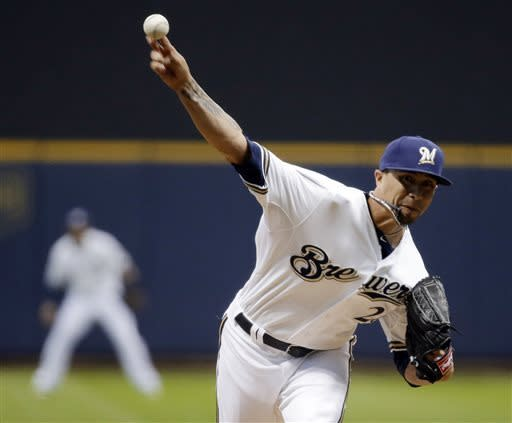 Milwaukee Brewers starting pitcher Kyle Lohse throws during the first inning of a baseball game against the Oakland Athletics on Tuesday, June 4, 2013, in Milwaukee. (AP Photo/Morry Gash)