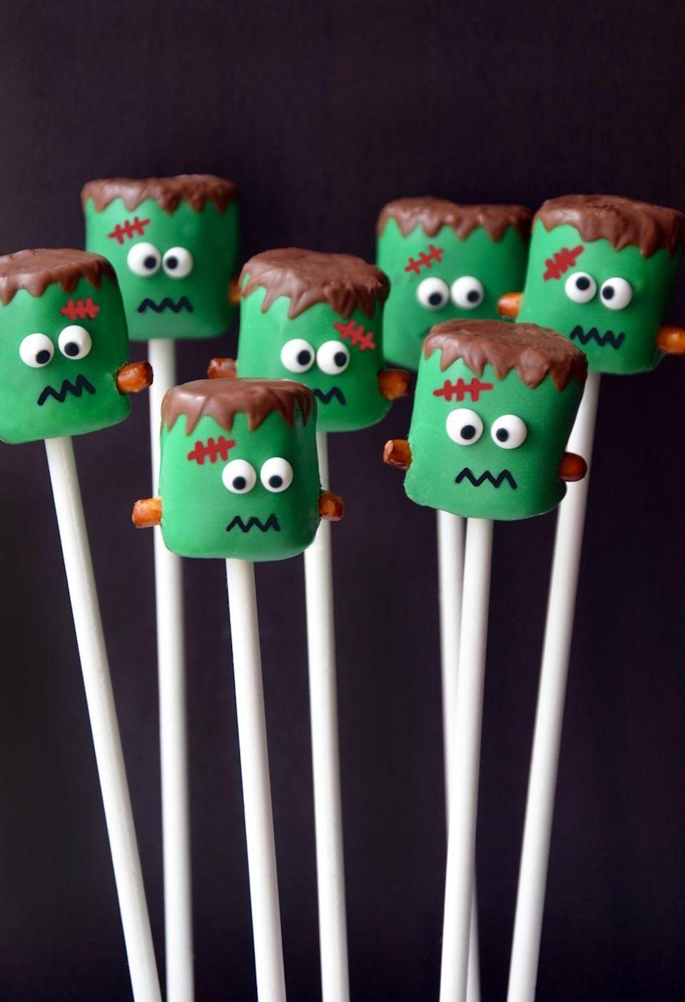 """<p>These little green guys will make anyone smile. Place them in a decorative container to dress up your dessert buffet. </p><p><a class=""""link rapid-noclick-resp"""" href=""""https://www.justataste.com/halloween-frankenstein-marshmallow-pops-recipe/"""" rel=""""nofollow noopener"""" target=""""_blank"""" data-ylk=""""slk:GET THE RECIPE"""">GET THE RECIPE</a></p>"""