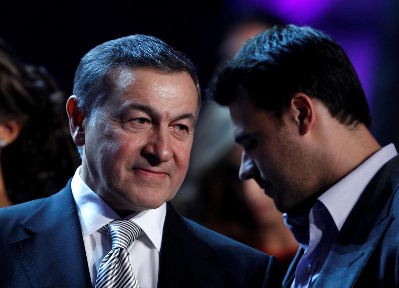 FILE PHOTO: Russian real estate developer Aras Agalarov (L) talks with his son, singer Emin Agalarov, during a news conference following the 2013 Miss USA pageant at the Planet Hollywood Resort & Casino in Las Vegas, Nevada June 16, 2013. Picture taken June 16, 2013.   REUTERS/Steve Marcus/File Photo