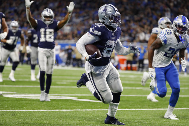 Dallas Cowboys running back Ezekiel Elliott (21) runs into the end zone for a touchdown during the second half of an NFL football game against the Detroit Lions, Sunday, Nov. 17, 2019, in Detroit. (AP Photo/Paul Sancya)