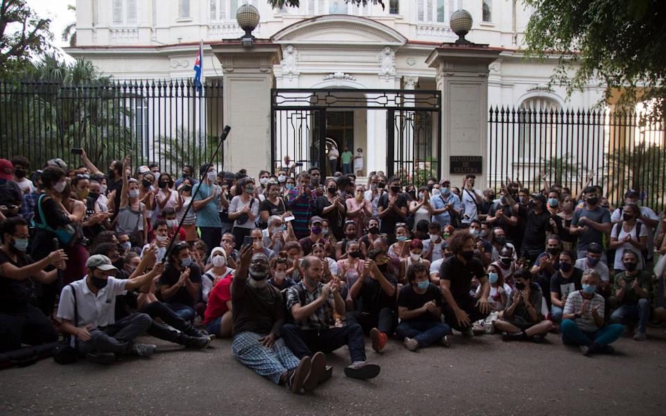 Young artists protest in front of the doors of the Ministry of Culture, in Havana, Cuba - AP Photo/Ismael Francisco