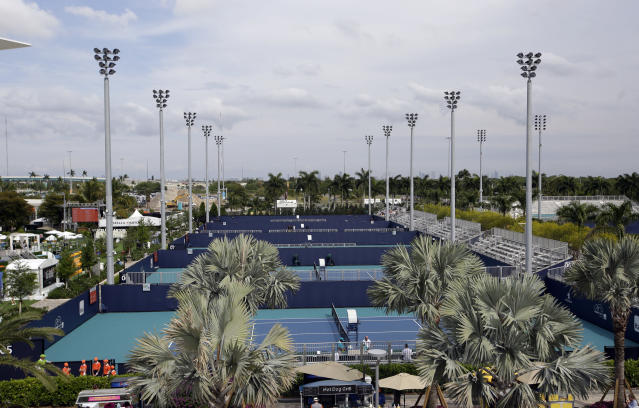 The outside courts of the Miami Open tennis tournament are viewed at Hard Rock Stadium, Monday, March 18, 2019, in Miami Gardens, Fla. The Miami Open has moved north from its home since 1987, the picturesque island of Key Biscayne, and will begin Tuesday at the home of the Miami Dolphins and the Miami Hurricanes. (AP Photo/Lynne Sladky)