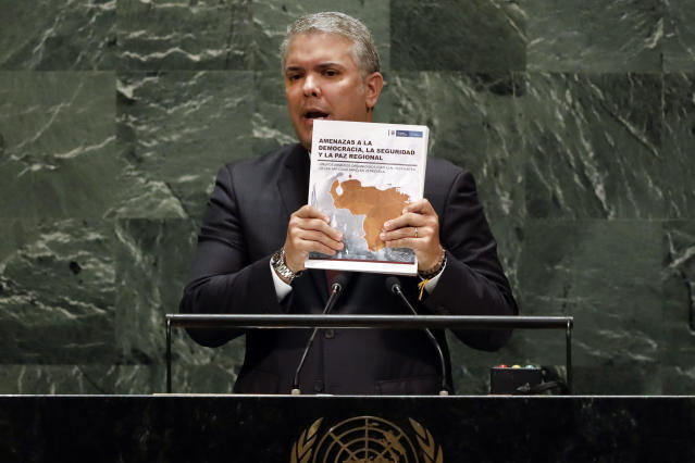 Colombia's President Ivan Duque holds a book as he addresses the 74th session of the United Nations General Assembly, Wednesday, Sept. 25, 2019. (AP Photo/Richard Drew)