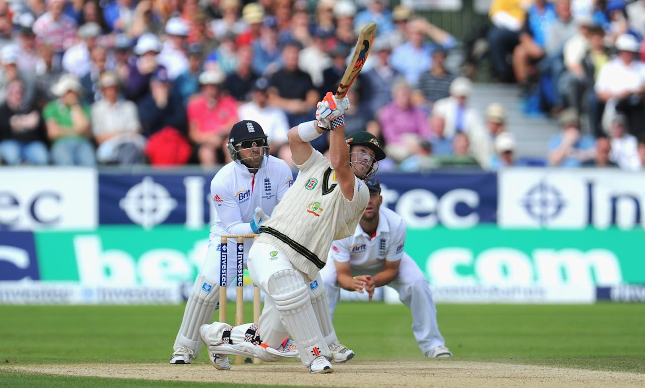 CHESTER-LE-STREET, ENGLAND - AUGUST 12:  Australain  batsman David Warner lofts Swann for 6 runs watched by Matt Prior during day four of 4th Investec Ashes Test match between England and Australia at Emirates Durham ICG on August 12, 2013 in Chester-le-Street, England.  (Photo by Stu Forster/Getty Images)