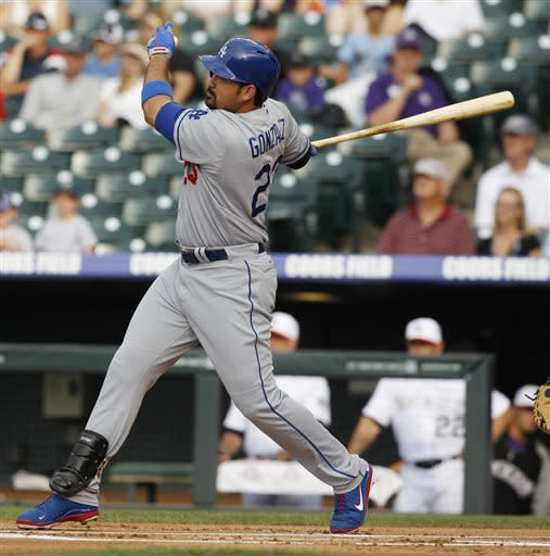 Los Angeles Dodgers' Adrian Gonzalez follows through on a single against the Colorado Rockies in the first inning of a baseball game in Denver on Thursday, July 4, 2013. (AP Photo/David Zalubowski)