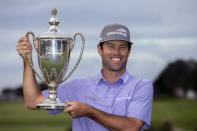 Robert Streb holds the trophy after winning a second hole playoff against Kevin Kisner at the RSM Classic golf tournament, Sunday, Nov. 22, 2020, in St. Simons Island, Ga. (AP Photo/Stephen B. Morton)