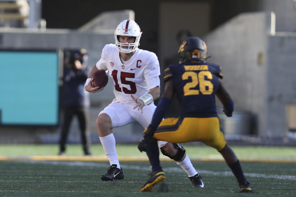 Stanford quarterback Davis Mills (15) runs against California safety Craig Woodson (26) during the first half of an NCAA college football game Friday, Nov. 27, 2020, in Berkeley, Calif. (AP Photo/Jed Jacobsohn)