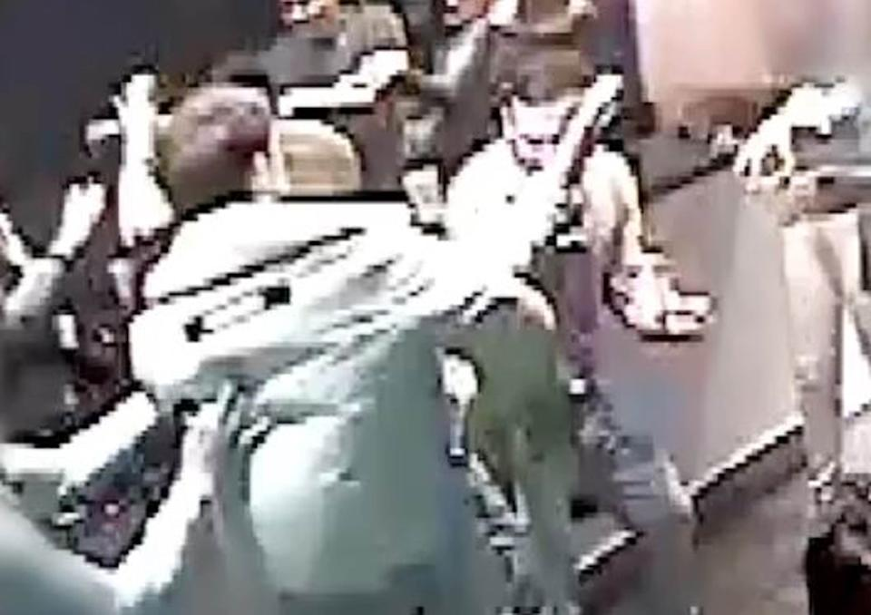 BEST QUALITY AVAILABLE Undated handout CCTV image issued by the Metropolitan Police, of Shane O'Brien (back to camera), one of Britain's most wanted fugitives who has been convicted of murder at the Old Bailey after a three-and-a-half-year international manhunt, during an attack on 21-year-old Josh Hanson (facing camera) who puts his hand up seconds after being slashed in the neck.